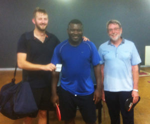 Braden presenting Kenneth (centre) and Allen (right) with their coffee vouchers from Carlo's Expresso Room and Eatery for winning the inaugural Carlos Coffee Tuesday Social Doubles Competition on Tuesday 30th January .